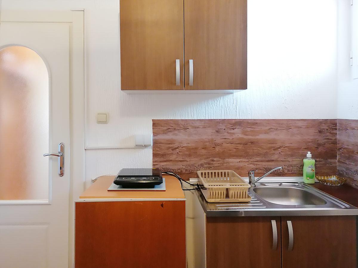 Apartman Hram 2 A 10 - Kuhinja, šporet, indukciona ploča